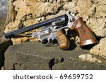 Two revolvers, one long barrel and one short. - stock photo