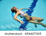 Small photo of The girl is engaged in aqua aerobics in the pool