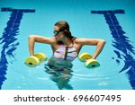 the girl is engaged in aqua... | Shutterstock . vector #696607495