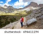 girl hiker hiking at the  tre... | Shutterstock . vector #696611194
