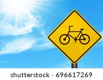 Bicycle warning sign on blue...