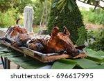barbecued suckling pig. served... | Shutterstock . vector #696617995