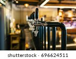 beer pump in nightclub. | Shutterstock . vector #696624511