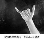 Small photo of Hand on black background fingerspelling the letter Y in sign language
