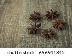 Small photo of Dried fruits of badian or Anisa on a wooden surface