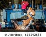 robot welding is welding... | Shutterstock . vector #696642655