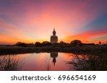 big golden buddha at wat muang... | Shutterstock . vector #696654169