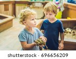 toddlers boy and girl caresses... | Shutterstock . vector #696656209