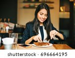 a happy young indian woman... | Shutterstock . vector #696664195