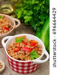 Small photo of Buckwheat porridge kasha with sweet bell peppers and carrots
