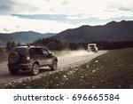 off road car on bad gravel road.... | Shutterstock . vector #696665584