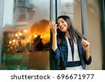 a happy young indian woman... | Shutterstock . vector #696671977