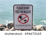 sign with text do not feed the... | Shutterstock . vector #696673165