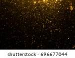 abstract gold bokeh with black... | Shutterstock . vector #696677044