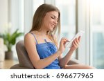 happy young woman tapping on... | Shutterstock . vector #696677965