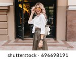 happy girl with trendy curly... | Shutterstock . vector #696698191
