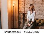 cute fair haired girl in white...   Shutterstock . vector #696698209