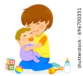 little boy hugging a baby | Shutterstock . vector #696700351