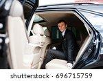 portrait of a handsome groom... | Shutterstock . vector #696715759