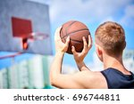 male playing basketball outdoor | Shutterstock . vector #696744811