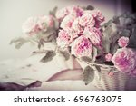 pink rose on wooden table... | Shutterstock . vector #696763075