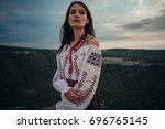 attractive woman in traditional ... | Shutterstock . vector #696765145
