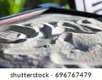 drawings on sand platform | Shutterstock . vector #696767479