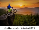 mountain biker riding on bike... | Shutterstock . vector #696769099