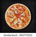bbq chicken pizza on a black... | Shutterstock . vector #696772531