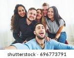 best friends taking selfie... | Shutterstock . vector #696773791