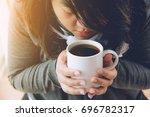 beautiful women are drinking... | Shutterstock . vector #696782317