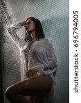 sexy brunette in wet shot...   Shutterstock . vector #696794005