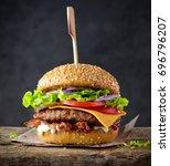 fresh tasty burger on wood table | Shutterstock . vector #696796207