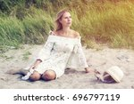 beautiful blond woman in white... | Shutterstock . vector #696797119