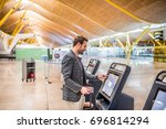 happy man using the check in... | Shutterstock . vector #696814294