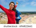 beautiful female tourist using... | Shutterstock . vector #696822661