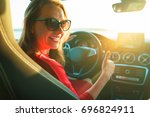 happy woman in red dress with... | Shutterstock . vector #696824911