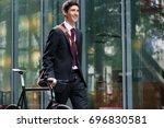 happy active young man wearing... | Shutterstock . vector #696830581