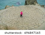 Girl Playing In A Rock Maze On...