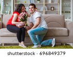 young couple family expecting a ... | Shutterstock . vector #696849379