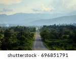 rural road in green grass and... | Shutterstock . vector #696851791