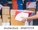 delivery a man carrying package ... | Shutterstock . vector #696872719