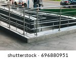 ramp for wheelchair entry with... | Shutterstock . vector #696880951