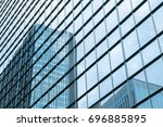 a group of modern skyscrapers... | Shutterstock . vector #696885895