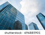 a group of modern skyscrapers... | Shutterstock . vector #696885901