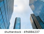 a group of modern skyscrapers... | Shutterstock . vector #696886237
