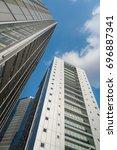a group of modern skyscrapers... | Shutterstock . vector #696887341