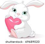 small lovely rabbit holds love...