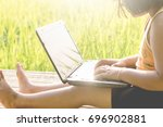 the girl is using a computer... | Shutterstock . vector #696902881