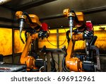 robots welding team in the... | Shutterstock . vector #696912961